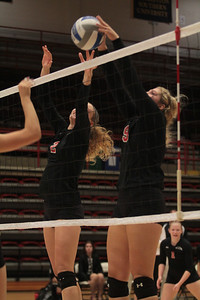 Number 9, Callie Hildebrand, and number 2, Amanda Murphy, block a spike.