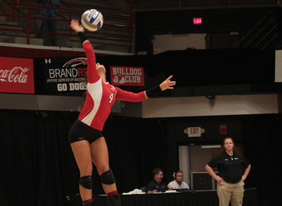 Number 4, Anna Pashkova, serves the ball.