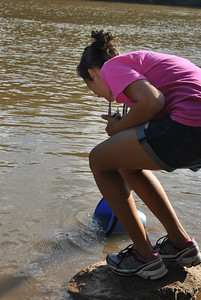 Student getting water from the Broad river.