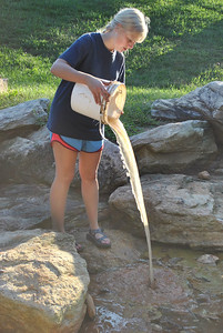 Student returning the Water she carried to the Boiling Springs.