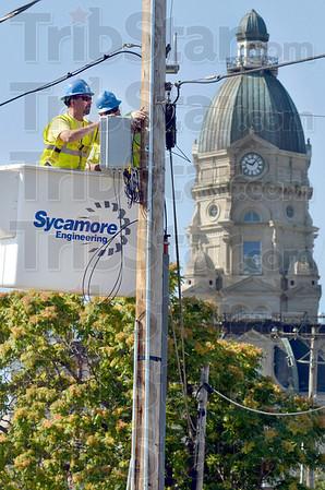 Tribune-Star/Joseph C. Garza<br /> Internet gateway: Sycamore Engineering journeymen electricians Doug Bursott and Chris Craffets install a Wifi gateway Thursday near the Vigo County Courthouse off of Third Street.