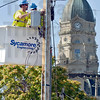 Tribune-Star/Joseph C. Garza<br /> Internet gateway: Sycamore Engineering journeymen electricians Doug Bursott and Chris Craffets install a Wifi gateway Thursday near the Vigo County Courthouse off of Third Street.