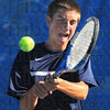 "Tribune-Star/Jim Avelis<br /> ""A"" for effort: Terre Haute North #1 singles player Tate Egan returns a shot to Nathan Bogle."