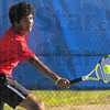 Tribune-Star/Jim Avelis<br /> On the run: Terre Haute South #2 singles player Krishan Kumar runs down a hit from Ethan Caldwell.