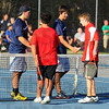 Tribune-Star/Jim Avelis<br /> Congrats: Terre Haute North #1 doubles partners Sam Wolf and Alex Farmer end their match with the Terre Haute South duet of Reed Crawford and Alex Barksdale with a handshake.