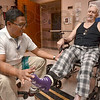 Tribune-Star/Joseph C. Garza<br /> PT: Physical Therapist Rommel Abalos helps patient Raymond Werner through his therapy Tuesday at Regional Hospital. The inpatient physical therapy department hosted an open house Tuesday.