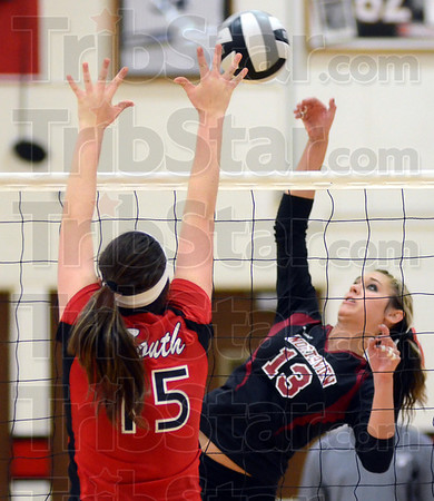 Tribune-Star/Jim Avelis<br /> Over the top: Northview outside hitter Shelbi Morris hits over the reach of Terre Haute South defender Bailee Williams in the second game of their match.