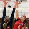 Tribune-Star/Jim Avelis<br /> Killer instinct: Terre Haute South outside hitter Elizabeth Weber gets a kill past the defense of Northview's Morgan Stearley.