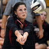 Tribune-Star/Jim Avelis<br /> Setter too: Northview middle hitter Brylie Riddell sets up a team mate in the Knight's game with Terre Haute South Tuesday evening in the Brave's gym.