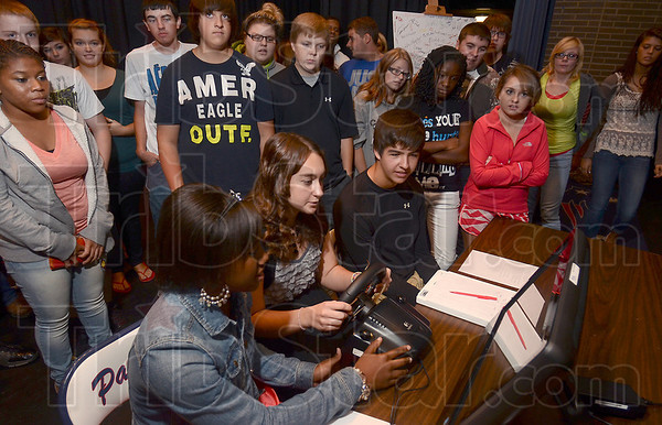 Tribune-Star/Joseph C. Garza<br /> Hands on the ten and two: Terre Haute North senior Morgan Cook tries a simulator that challenges the driver to text and drive at the same time during a presentation Tuesday at the school.
