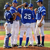 Tribune-Star file photo/Bob Poynter<br /> Consultation: Rex manager Brian Dorsett talks with his pitcher and players during a time-out Sunday, July 15 at Sycamore Stadium.