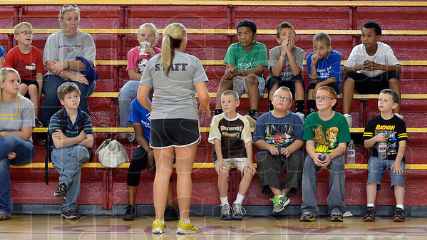 Tribune-Star/Joseph C. Garza<br /> First, a few rules: Terre Haute Boys & Girls Club Program and Education Director Kalie Schmidt explains a few rules to youngsters, staff and parents Tuesday at the club's second location in the former Chauncey Rose Middle School.