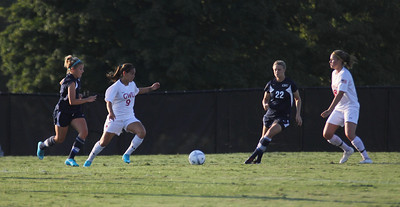 Samantha Gutierrez (9) passes the ball off to Megan Curan (8)