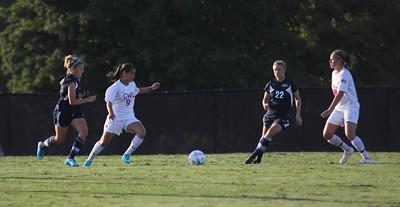 Samantha Gutierrez (9) passes the ball off to Megan Curan (8)