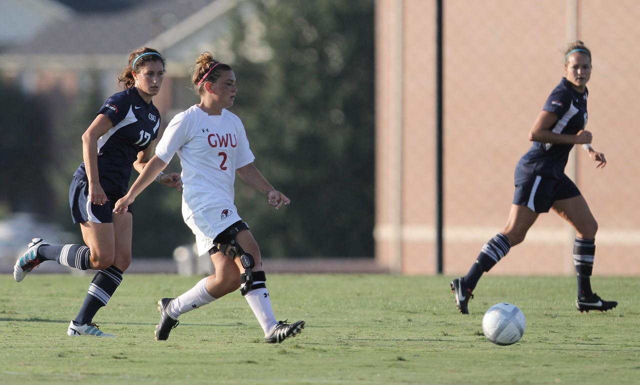 Arielle McCarthy (2) kicks the ball