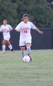 Karyn Latorre (14) dribbles the ball down the field.