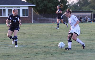 Arielle McCarthy (2) takes the ball towards the goal.