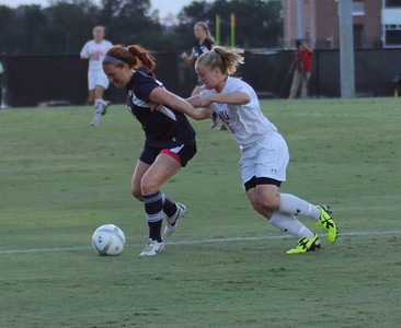 Mary Toohey (6) attempts to steal the ball from Charleston Southern.