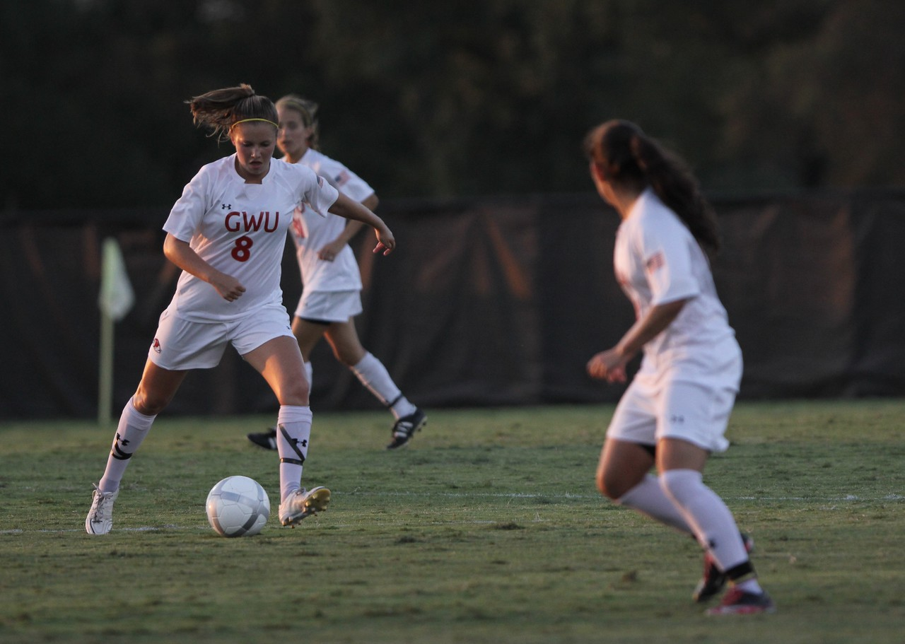 Megan Curan (8) dribble's the ball before passing to a team mate
