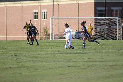 Karyn Latorre (14) dribbles the ball down the field.
