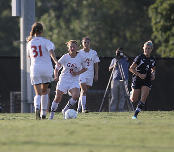 Megan Curan (8) dribble's the ball down the field