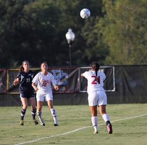 Brianna Fraire (21) passes the ball to Brooke Kelly (18)