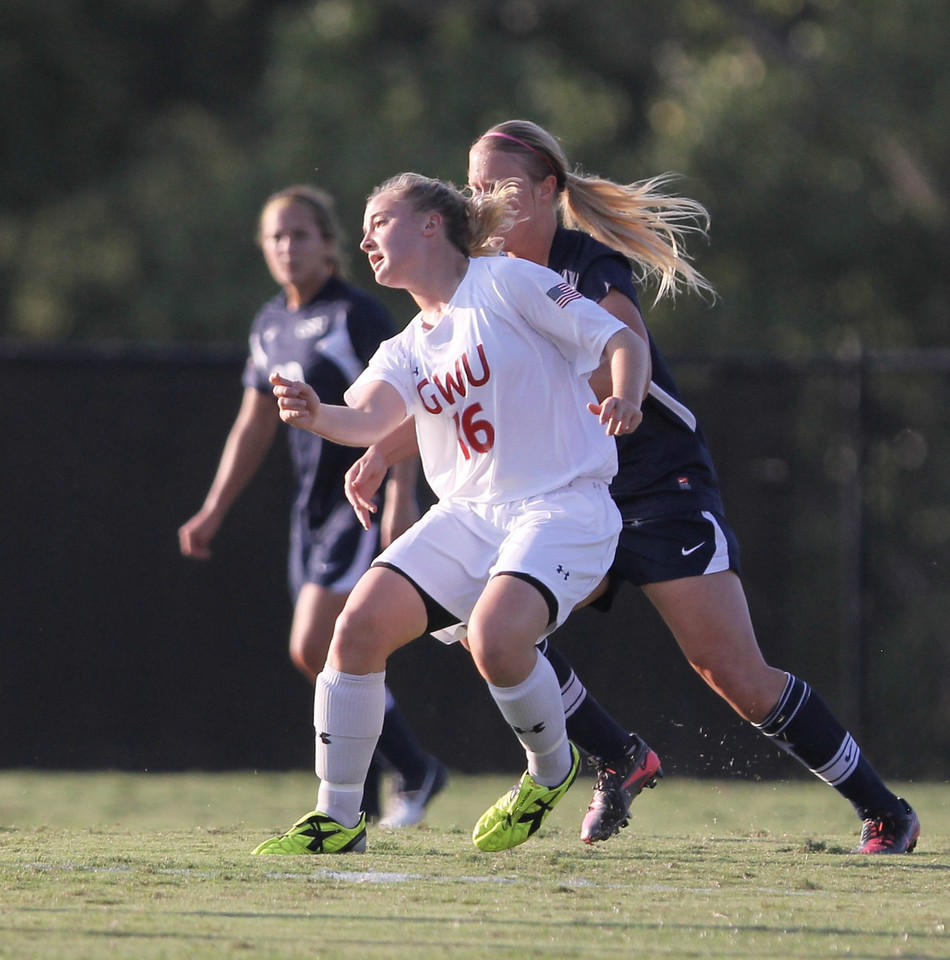 Shelby Hooe (16) pushes to keep the ball away from Charleston Southern