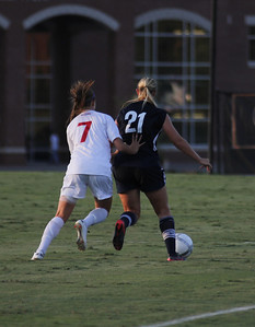 Ashley Carmean (7) attempts to steal the ball from Charleston Southern.