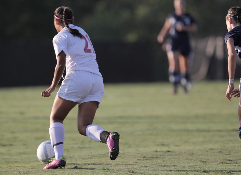 Brianna Fraire (21) husstles down the field