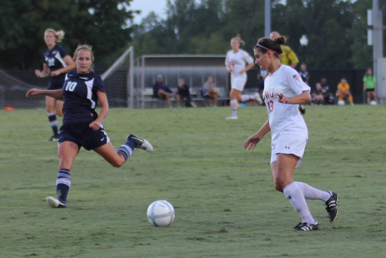 Tori James (13) passes the ball off to another player.