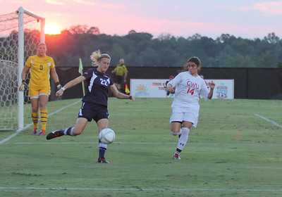 Karyn Latorre (14) attempts to block Charleston Southern player's kick.