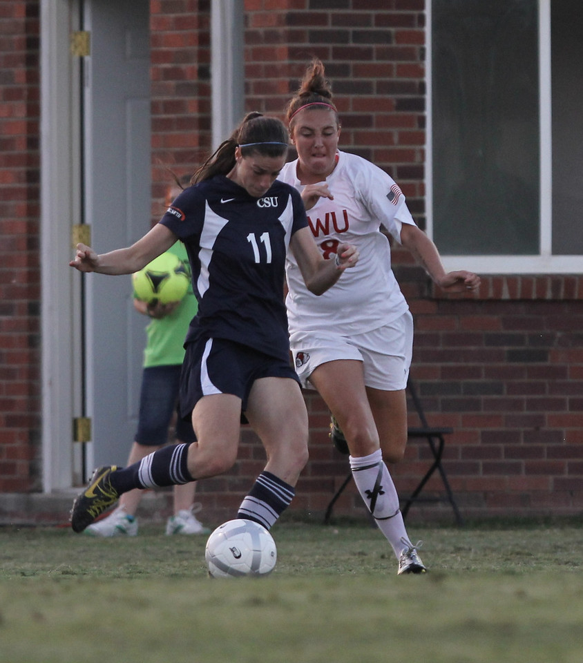 Brooke Kelly (18) fights against Charleston Southern's player