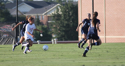 Arielle McCarthy, (2) passes the ball off to a team mate.