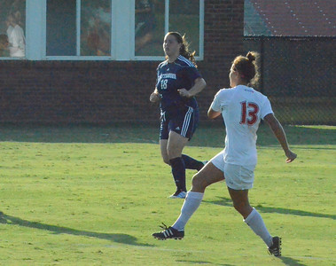 Tori James (13) makes a pass to one of her teamates while running down the field.