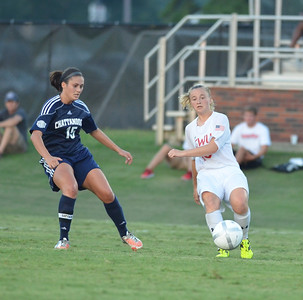 Shelby Hooe (16) pushes to keep the ball away from Chattangoo's player.