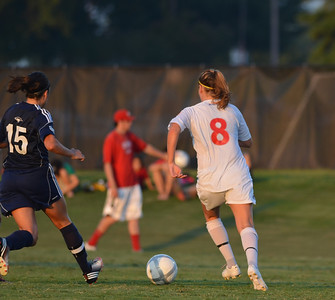 Megan Curan (8) pushes to keep the ball from the opposing side, hoping to score.