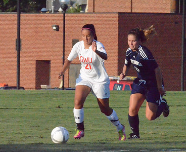 Brianna Fraire (21) husstles to keep the ball away from the opposing team.