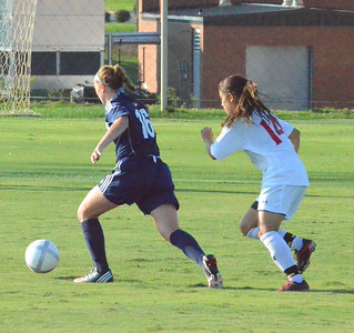 Karyn Latorre (14) hustles to try and get the ball from her opponent.