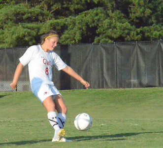 Megan Curan (8) kicks the ball to send it down the field.