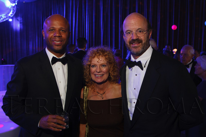 """Ryan Frazier with Kathleen and Chris Pelley.  The 2012 Illumination Gala, themed """"Trip the Light Fantastic"""" and benefiting the Auraria Library, at The Denver Center for the Performing Arts, Seawell Ballroom, in Denver, Colorado, on Friday, Sept. 7, 2012.<br /> Photo Steve Peterson"""