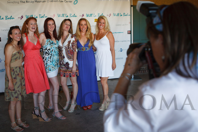 Susan English takes a photo of Emilie Beaver, Jennifer Peck, Holly Chatelain, Brooke Hipp, Brooke Fogg, and Kerri Butler.  Havana Nights, a benefit for Children's Law Center, at the Denver City Park Pavilion in Denver, Colorado, on Saturday, Sept. 15, 2012.<br /> Photo Steve Peterson