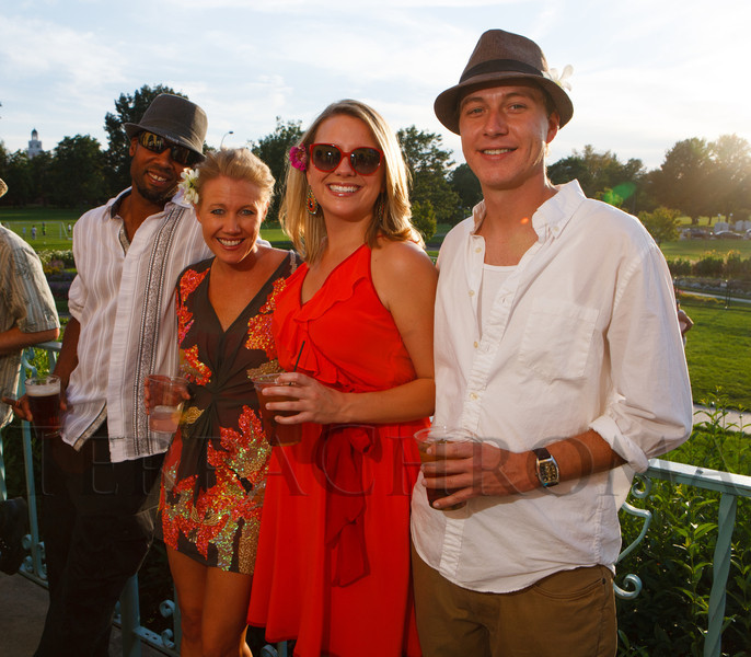 Charles Griffin, Brittney Wilson (owner of Canvas and Cocktails, an event sponsor), Lindsey Book, and Whit Wilson.  Havana Nights, a benefit for Children's Law Center, at the Denver City Park Pavilion in Denver, Colorado, on Saturday, Sept. 15, 2012.<br /> Photo Steve Peterson