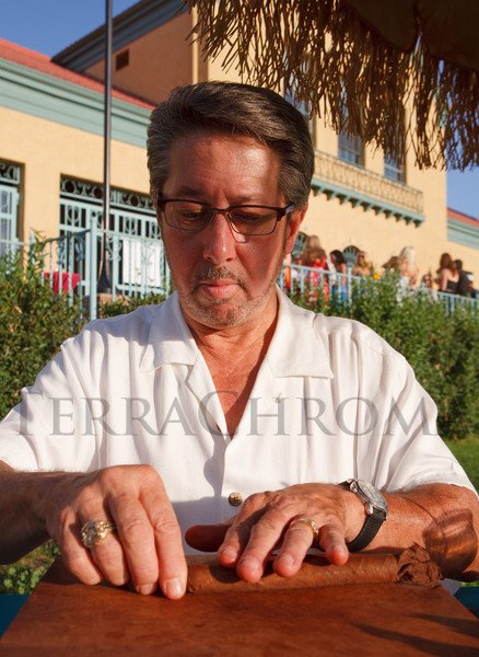 Clay Carlton, of Palma Cigars, rolls a few dozen Dominican cigars for inquisitive guests.  Havana Nights, a benefit for Children's Law Center, at the Denver City Park Pavilion in Denver, Colorado, on Saturday, Sept. 15, 2012.<br /> Photo Steve Peterson