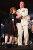 Arc Ambassador Lisa, escorted by Lawrence French.  Starfish and Dreams Co-Chair Lawrence French escorting Arc Ambassador Lisa.  Starfish and Dreams 'n All That Jazz gala, benefiting Arc Thrift Stores, at the Gold Crown Field House in Lakewood, Colorado, on Friday, Sept. 21, 2012.<br /> Photo Steve Peterson