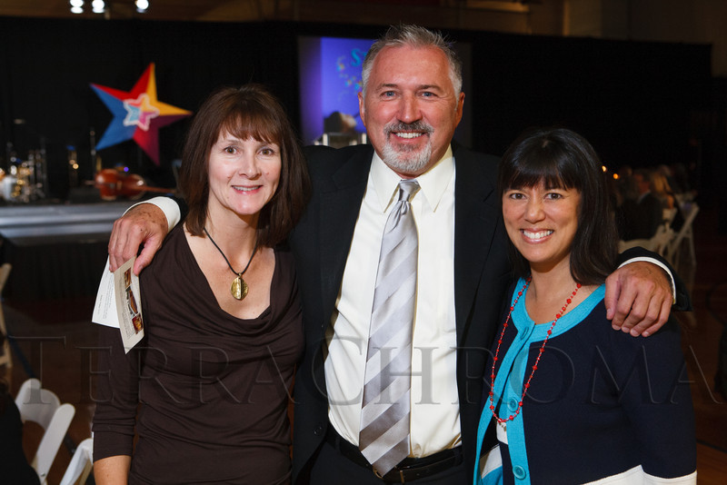 Mary Tuten, Lloyd Lewis, and Michelle Sie Whitten.  Starfish and Dreams 'n All That Jazz gala, benefiting Arc Thrift Stores, at the Gold Crown Field House in Lakewood, Colorado, on Friday, Sept. 21, 2012.<br /> Photo Steve Peterson
