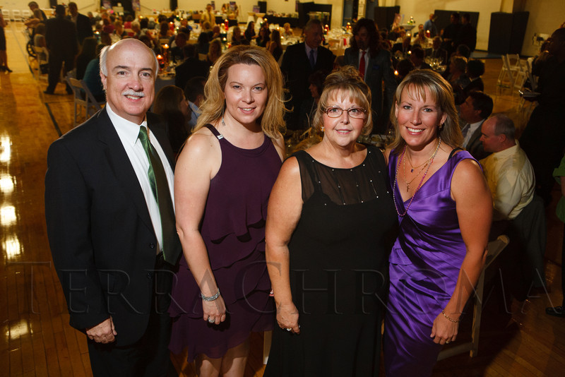 With Colorado State Bank and Trust:  Kevin Shaw, Kristen Sundin, Robbi Casey, and Nicole Dews.  Starfish and Dreams 'n All That Jazz gala, benefiting Arc Thrift Stores, at the Gold Crown Field House in Lakewood, Colorado, on Friday, Sept. 21, 2012.<br /> Photo Steve Peterson