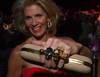 Joy Dinsdale with her Alexander McQueen Knuckle Duster Clutch.  The Opera Colorado 30th Anniversary Gala at the Ellie Caulkins Opera House in Denver, Colorado, on Saturday, Sept. 22, 2012.<br /> Photo Steve Peterson
