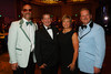 Brian Midtbo, Gwen and Keith Arnold, and Peter Harnisch.  The Bridge Project 21st Annual Gala, at the Hyatt Regency Denver at the Colorado Convention Center in Denver, Colorado, on Saturday, Sept. 29, 2012.<br /> Photo Steve Peterson