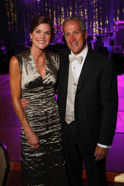 Leslie (dress by Nicole Miller) and Gary Howard.  The Bridge Project 21st Annual Gala, at the Hyatt Regency Denver at the Colorado Convention Center in Denver, Colorado, on Saturday, Sept. 29, 2012.<br /> Photo Steve Peterson
