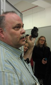 Assistant Collections Manager David Hunt displays one of the shrunken heads in the collection of the National Museum of Natural History's Department of Anthropology